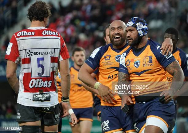 Montpellier's Fijian wing Nemani Nadolo is congratulated by his teammate Montpellier's Australian number 8 Caleb Timu after scoring a try during the...