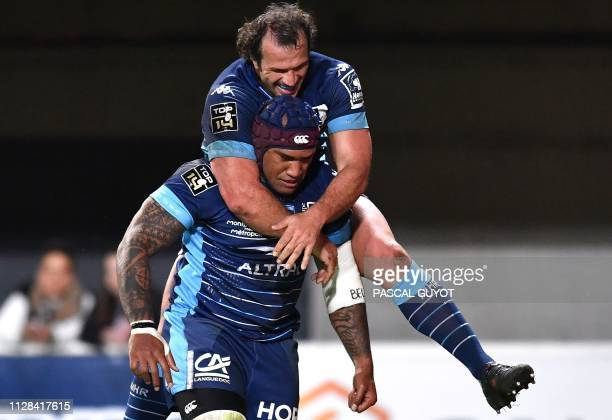 Montpellier's Fijian wing Nemani Nadolo is congratulated by Montpellier's South African hooker Bismarck du Plessis after scoring a try during the...