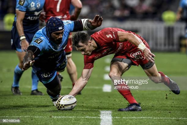 Montpellier's Fijian winger Nemani Nadolo vies with Lyon's New Zealander winger Toby Arnold during the French Top 14 union semifinal rugby match...