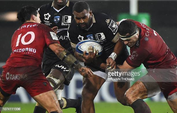 TOPSHOT Montpellier's Fijian winger Timoci Nagusa is tackled by RC Toulon's French flyhalf Francois TrinhDuc and French hooker Guilhem Guirado during...