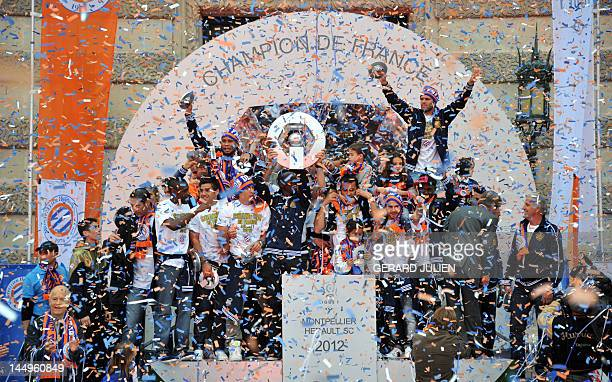 Montpellier's football club players celebrate with their trophy at the place de la Comedie on May 21 2012 in Montpellier southern France after the...