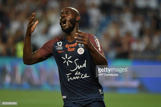 Montpellier's forward Giovanni Sio reacts during the French L1 football match between Montpellier and Strasbourg on August 19 at the La Mosson...