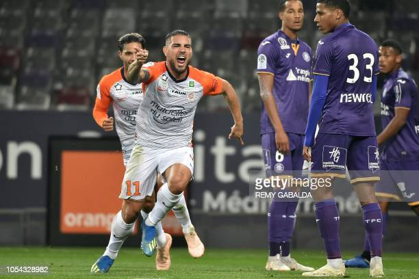 Montpellier's forwards Andy Delort celebrates with teammates after scoring a goal during the French L1 football match between Toulouse and Montpelier...