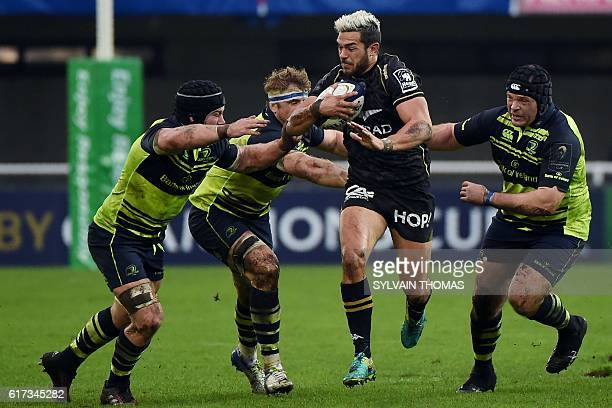 Montpellier's French centre Vincent Martin runs with the ball during the European Rugby Champions Cup rugby match between Montpellier and Leinster at...