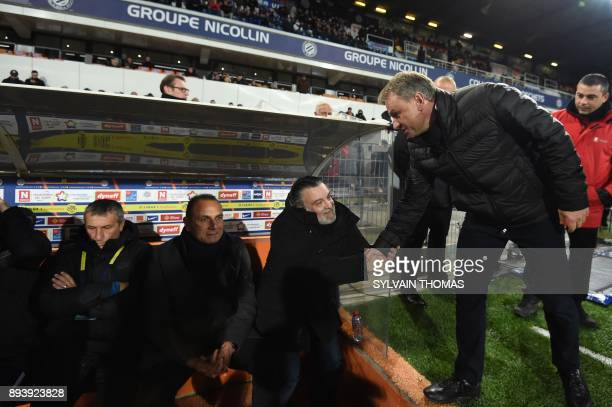 Montpellier's French club president Laurent Nicollin shakes hands with Metz' French head coach Frédéric Hantz next to Montpellier's French head coach...