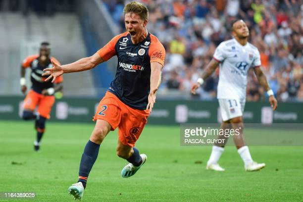 Montpellier's French defender Arnaud Souquet celebrates after scoring during the French L1 football match between Montpellier Herault SC and...