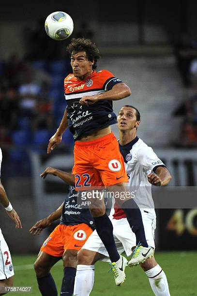 Montpellier's French defender Benjamin Stambouli jumps for the ball during the French L1 football match between Montpellier and Paris Saint-Germain...