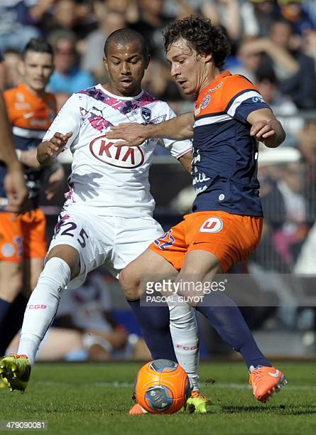 Montpellier's French defender Benjamin Stambouli vies for the ball with Bordeaux's Brazilian defender Ferreira Mariano during the French L1 football...