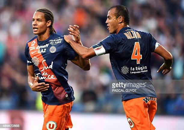 Montpellier's French defender Daniel Congre and Montpellier's Brazilian defender Vitorino Hilton react after scoring a goal during the French L1...