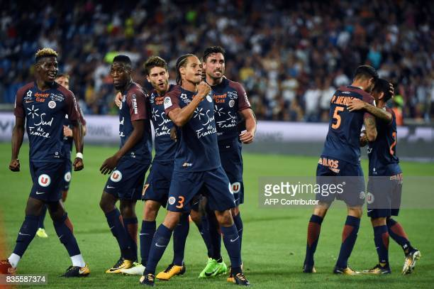 Montpellier's French defender Daniel Congre celebrates with his teammates after scoring a goal during the French L1 football match between...