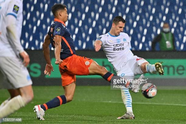 Montpellier's French defender Daniel Congre challenges Marseille's Polish forward Arkadiusz Milik during the French L1 football match between...