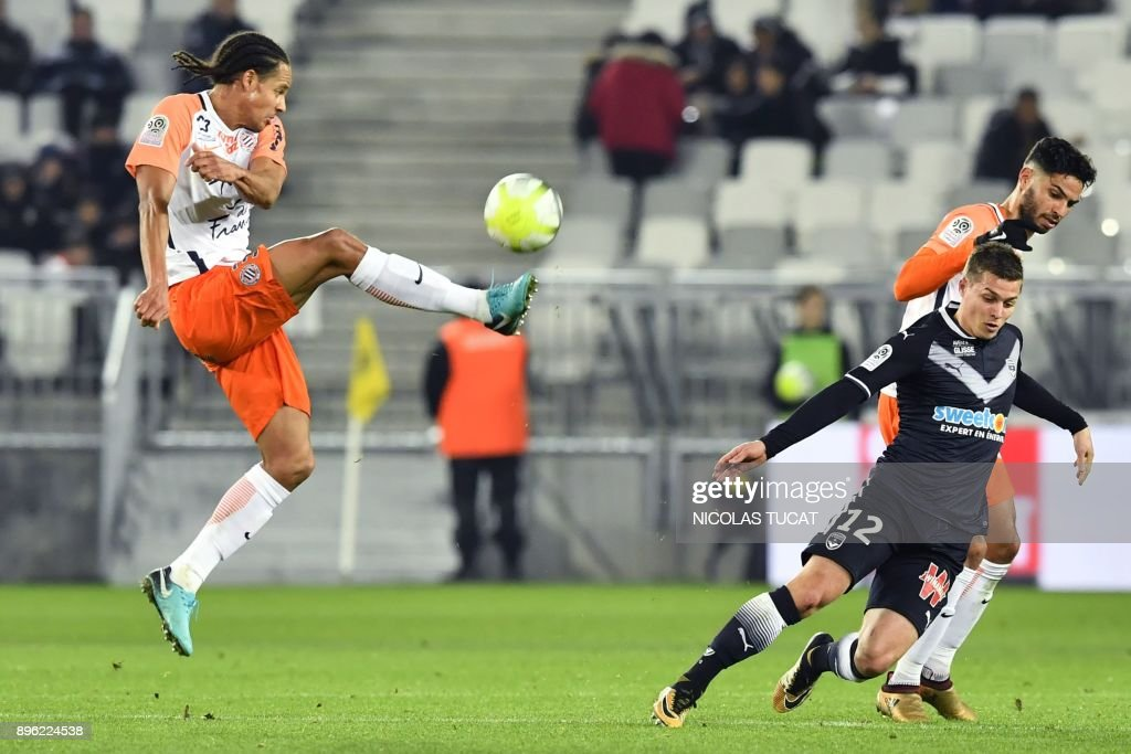 Montpellier's French defender Daniel Congre (L) controls the ball during the French L1 football match between Bordeaux (FCGB) and Montpellier (MHSC) on December 20, 2017, at the Matmut Atlantique stadium in Bordeaux, southwestern France. /