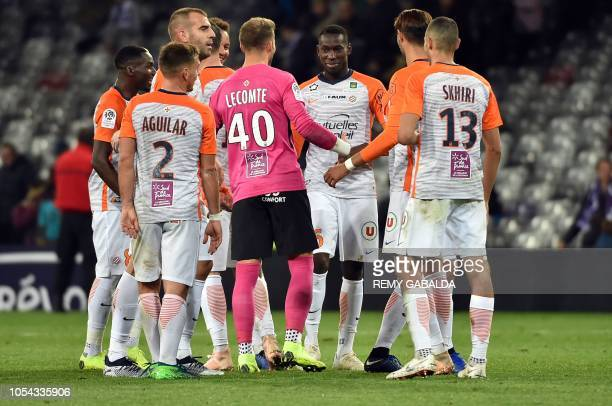 Montpellier's French defender Junior Sambia celebrates with teammates after scoring a goal during the French L1 football match between Toulouse and...
