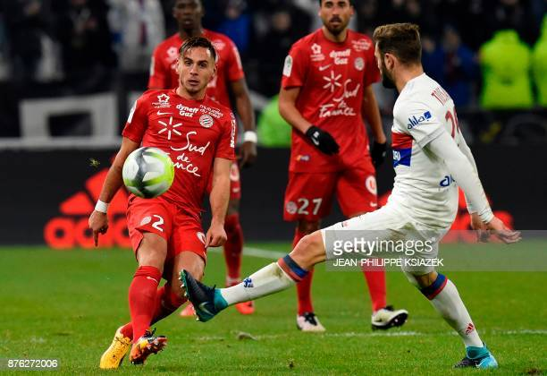 Montpellier's French defender Ruben Aguilar fights for the ball with Lyon's French midfielder Lucas Tousart during the French L1 football match Lyon...