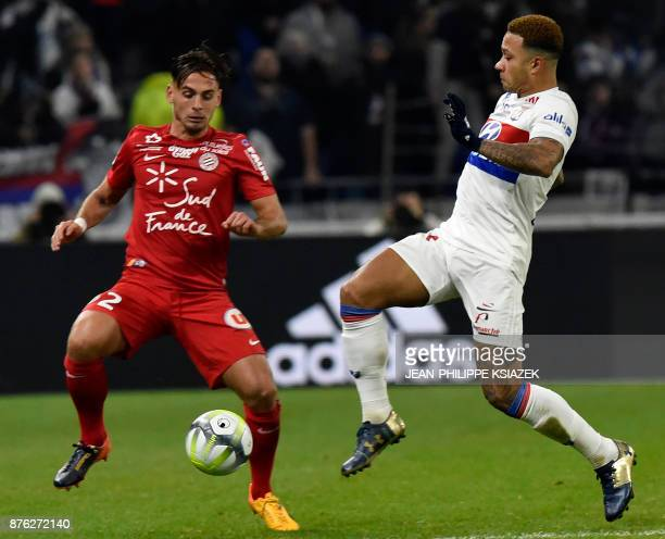 Montpellier's French defender Ruben Aguilar fights for the ball with Lyon's Dutch forward Memphis Depay during the French L1 football match Lyon vs...
