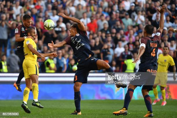 Montpellier's French defender Ruben Aguilar Paris SaintGermain's Brazilian forward Lucas and Montpellier's French defender Daniel Congré go for the...