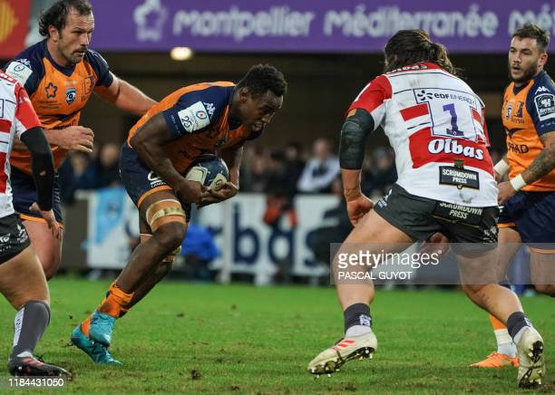 Montpellier's French flanker Fulgence Ouedraogo vies with Gloucester's New Zealand prop Josh Hohneck during the European Rugby Champions Cup Pool 5...