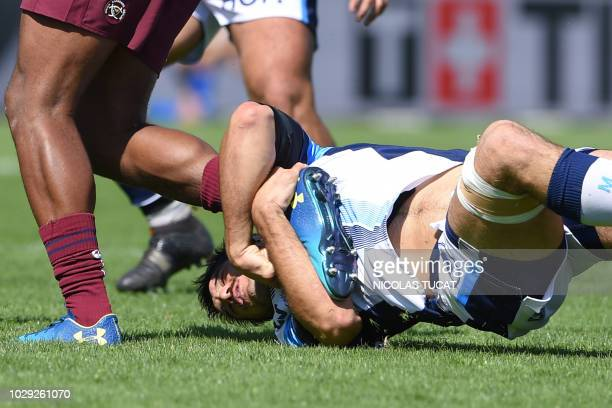 Montpellier's French flanker Kelian Galletier tackles a BordeauxBegles' player during the French Top 14 rugby union match between BordeauxBegles and...