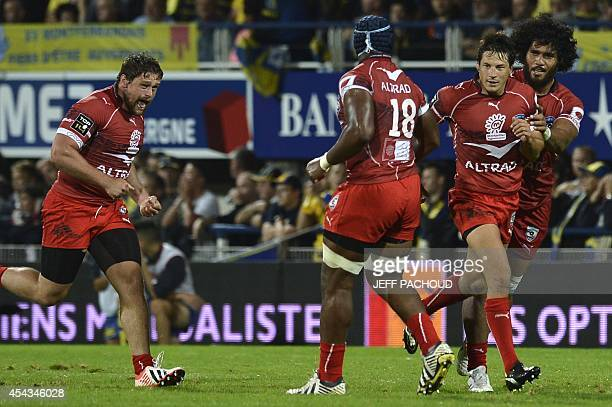 Montpellier's French flyhalf Francois TrinhDuc celebrates with his teamates after scoring the winning point during the French Top 14 rugby union...
