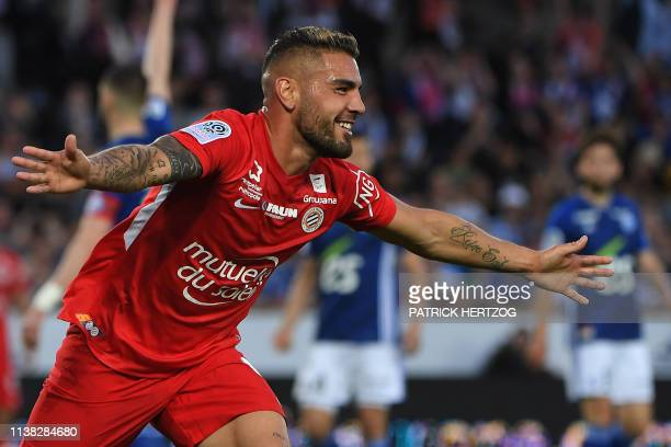 Montpellier's French forward Andy Delfort celebrates after scoring a goal during the French L1 football match between Strasbourg and Montpellier on...