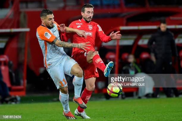 Montpellier's French forward Andy Delort fights for the ball with Dijon's French midfielder Romain Amalfitano during the French L1 football match...