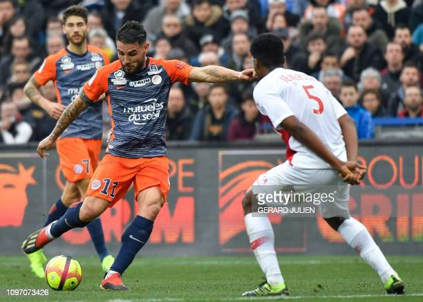 Montpellier's French Forward Andy Delort prepares to kick in front of Monaco's Brazilian defender Jemerson during the French L1 football match...