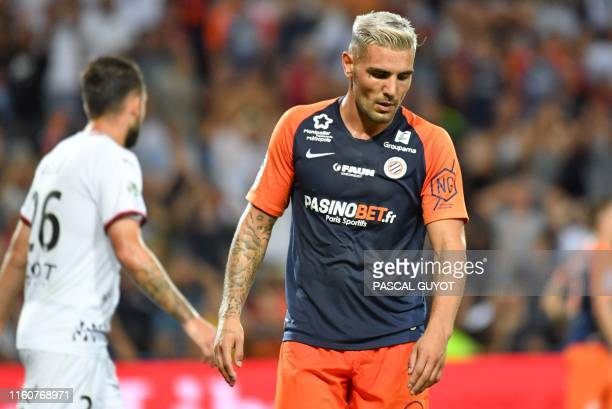 Montpellier's French forward Andy Delort reacts during the French L1 football match between Montpellier and Rennes at the Mosson stadium in...