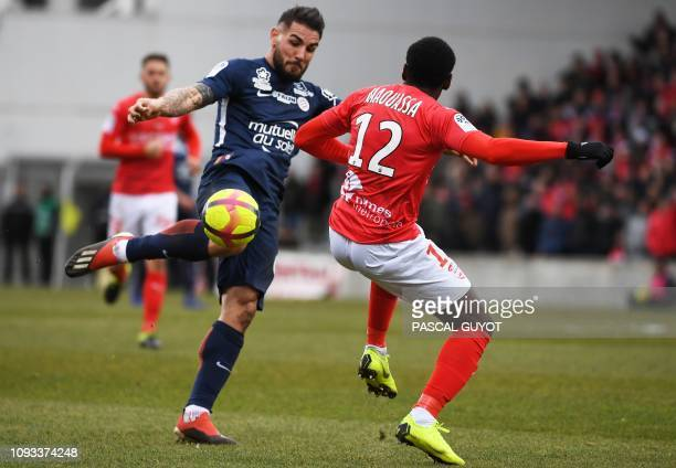 Montpellier's French forward Andy Delort vies for the ball with Nimes' French midfielder Faitout Maouassa during the French L1 football match between...