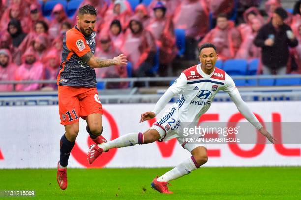 Montpellier's French Forward Andy Delort vies with Lyon's Dutch defender Kenny Tete during the French L1 football match between Lyon and Montpellier...