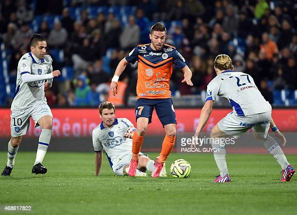 Montpellier's French forward Anthony Mounier vies with Bastia's French midfielder Guillaume Gillet Bastia's French midfielder Yannick Cahuzac and...