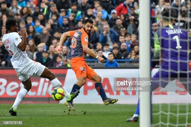 Montpellier's French forward Gaetan Laborde kicks the ball next to Monaco's Brazilian defender Jemerson and in front of Monaco's Croatian goalkeeper...