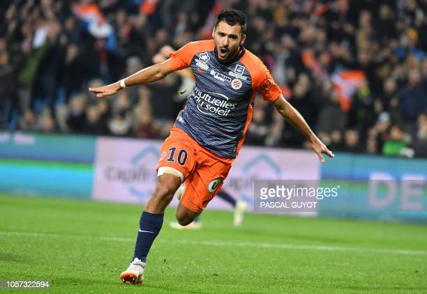 Montpellier's French forward Gaetan Laborde reacts after scoring a goal during the French L1 football match between Montpellier and Marseille at the...