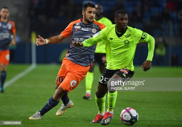 Montpellier's French forward Gaetan Laborde vies with Lille's French defender Fode BalloToure during the French L1 football match between Montpellier...
