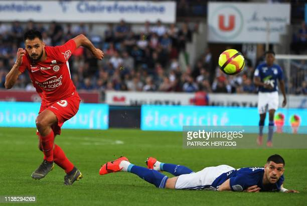Montpellier's French forward Gaetan Laborde vies with Strasbourg's Serbian defender Stefan Mitrovic during the French L1 football match between...
