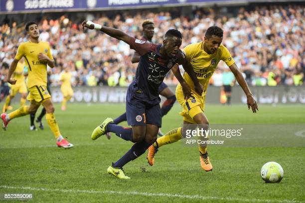 Montpellier's French forward Isaac Mbenza and Paris SaintGermain's Brazilian defender Marquinhos go for the ball during the French Ligue 1 football...