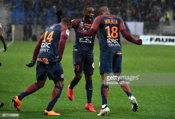 Montpellier's French forward Isaac Mbenza celebrates after scoring a goal with his teammates during the French L1 football match between Montpellier...