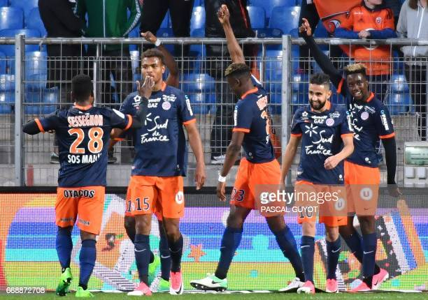 Montpellier's French forward Isaac Mbenza celebrates with teammates after scoring a goal during the French L1 football match between MHSC Montpellier...