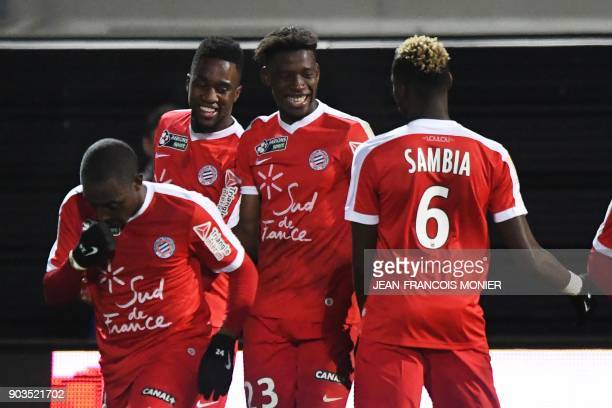Montpellier's French forward Isaac Mbenza celebrates with teammates after scoring a goal during the French League Cup quarterfinal football match...