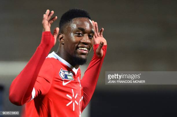 Montpellier's French forward Isaac Mbenza gestures after winning the French League Cup quarterfinal football match between Angers and Montpellier at...