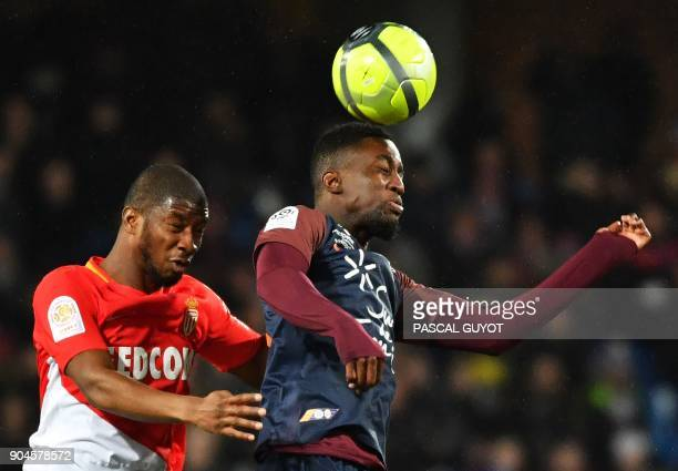 Montpellier's French forward Isaac Mbenza heads the ball next to Monaco's Malian defender Almamy Toure during the French L1 football match between...
