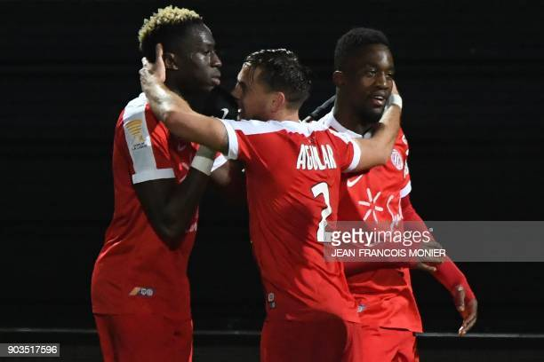 Montpellier's French forward Isaac Mbenza is congratulated by teammates after scoring a goal during the French League Cup football match between...
