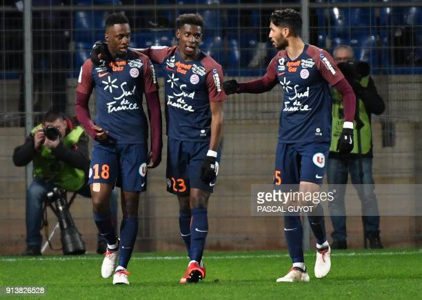 Montpellier's French forward Isaac Mbenza is congratulated by teammates after scoring a goal during the French L1 football match between MHSC...