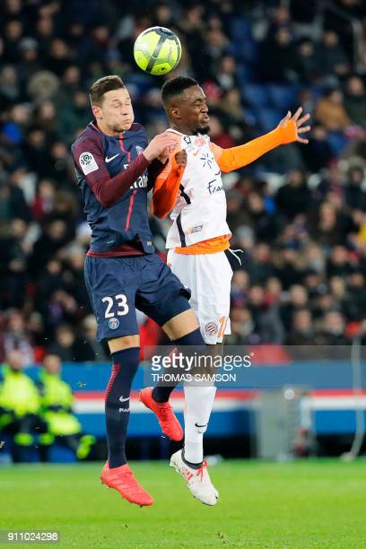 Montpellier's French forward Isaac Mbenza jumps for the ball with Paris SaintGermain's German midfielder Julian Draxler during the French L1 football...