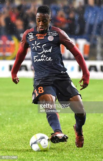 Montpellier's French forward Isaac Mbenza runs with the ball during the French L1 football match between MHSC Montpellier and Amiens on November 4...