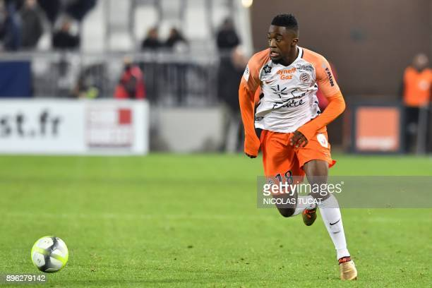 Montpellier's French forward Isaac Mbenza runs with the ball during the French L1 football match between Bordeaux and Montpellier on December 20 at...