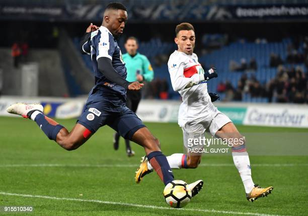 Montpellier's French forward Isaac Mbenza vies with Lyon's Brazilian defender Fernando Marcal during the French Cup round of 8 football match...