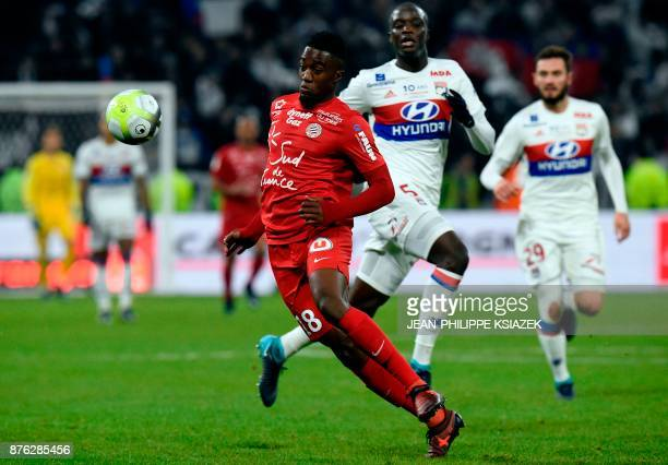 Montpellier's French forward Isaac Mbenza vies with Lyon's defender Mouctar Diakhaby during the French L1 football match between Lyon and Montpellier...