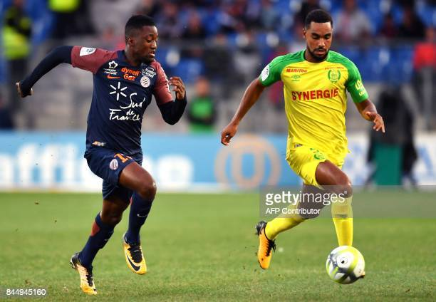 Montpellier's French forward Isaac Mbenza vies with Nantes' French defender Levy Djidji during the French L1 football match between Montpellier and...
