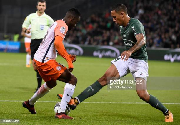 Montpellier's French forward Isaac Mbenza vies with SaintEtienne's French defender Leo Lacroix during the French L1 football match SaintEtienne vs...