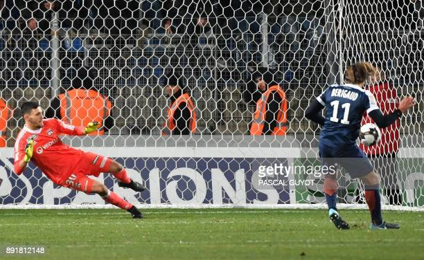 Montpellier's French forward Kevin Brigaud scores a penalty during the French League Cup round of 16 football match between Montpellier and Lyon at...